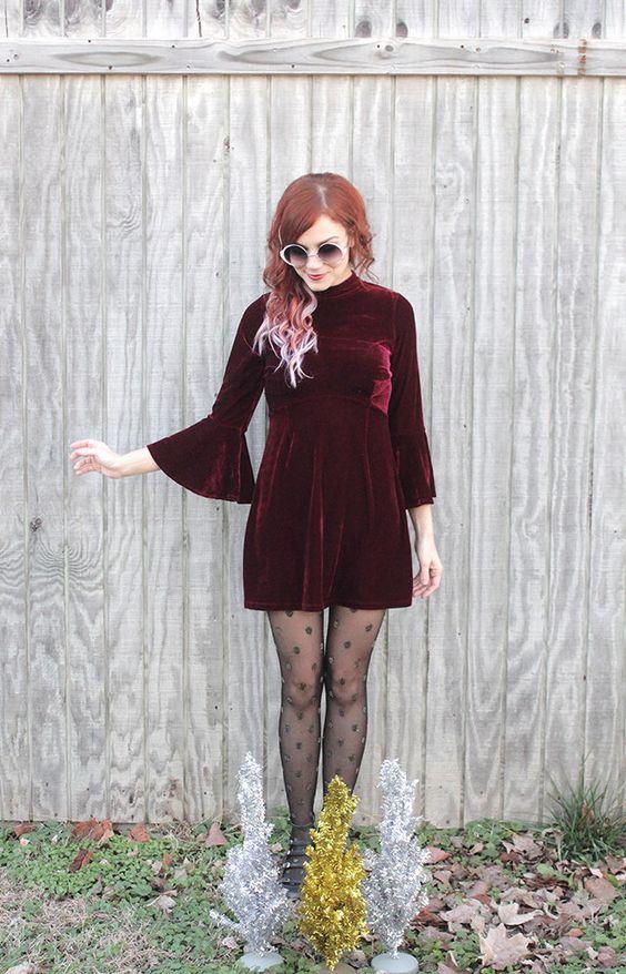 Polka dot tights!! I also love the flared velvet dress. Very 70s!