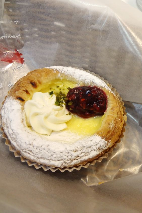 cream cheese pastry with whipped cream and berry jam
