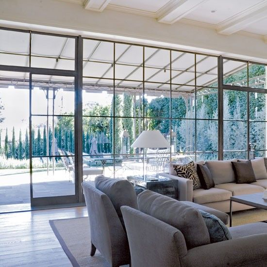 Floor to ceiling is modern, but these windows have traditional mullions