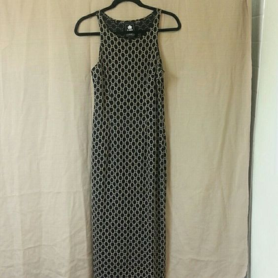 Semi-Sheer Maxi Dress SEXY DRESS!!! 19 inch slit in back. Black and beige. Semi-sheer. No size on tag - stretchy material looks to me like it would fit most sizes. Up Front Dresses Maxi