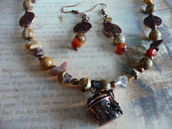This collection is an earring and necklace set. The necklace which measures 26 inches is crafted from Picasso Jasper, Tourmaline, Rose Quartz, Picture Jasper and is complete with a beautiful Wish Box Charm.