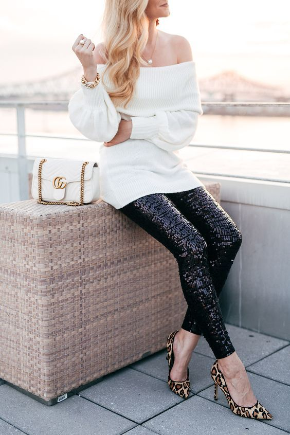 a white off the shoulder sweater, black sequin leggings, leopard print shoes and a white bag