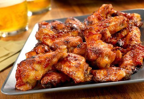 Getting bored with buffalo wings? Give these flavor-packed wings a try...they're baked instead of fried, and they're glazed with a sweet and spicy sauce that's out of this world!