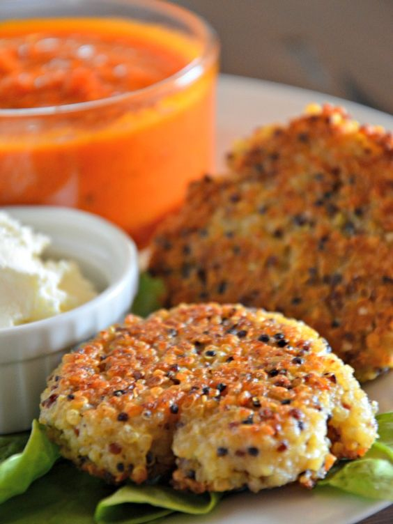 These parmesan quinoa cakes are so easy and good served with whipped feta spread and marinara sauce. www.mountainmamacooks.com