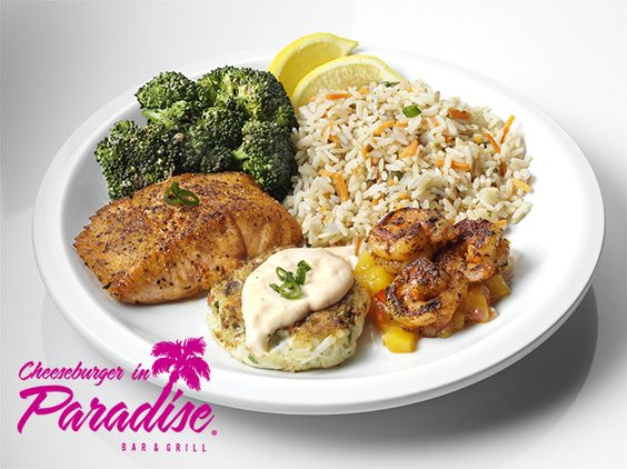The CIP Coastal Trio! This limited time feature brags a sampling of our coastal favorites including a fresh hand made crab cake, 1/2 portion of our #KingstonSalmon and perfectly #blackenedshrimp served with #Teriyakibroccoli and Island rice.  http://www.cheeseburgerinparadise.com/menu/islandspecialties.php