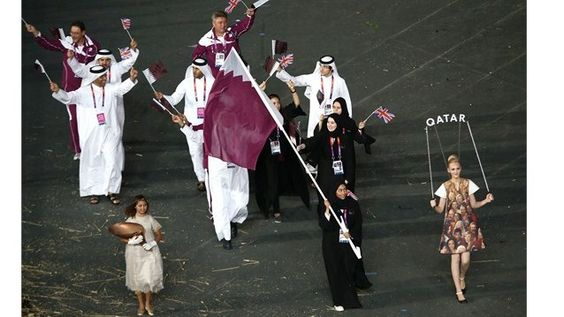 Members of the Qatar delegation enter the Olympic StadiumBahya Mansour Al Hamad of the Qatar Olympic shooting team carries her country's flag during the Opening Ceremony of the London 2012 Olympic Games at the Olympic Stadium.