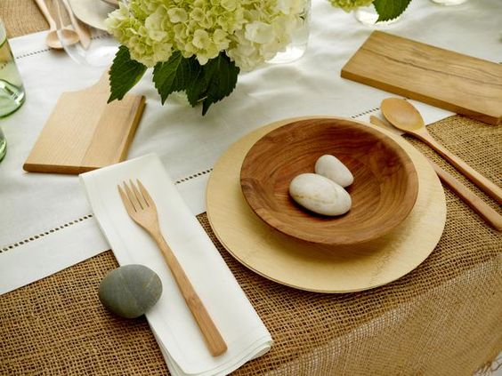 With minimal effort and natural weights (like these rocks) you can secure your plates and napkins in style.