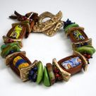 Serving as one of several focal points on the bracelet are four millifore patterned antique/vintage (Circa late 1800's – early 1900's) Venetian trade beads (also known as African Trade Beads).: