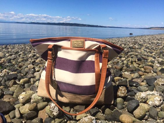 I now use my bag as my purse and love it.  I have been asked what makeup I carry in my purse and all I carry is either my lip gloss or lip bonbon...I used to have a bag in my purse JUST for makeup that I would use to touch up after work or even at lunch... Now that I have a HUGE purse I have room to carry my computer in it instead of makeup!    PHOTO CREDIT: Brittney Barber, she took her beach bag to the beach near her house!