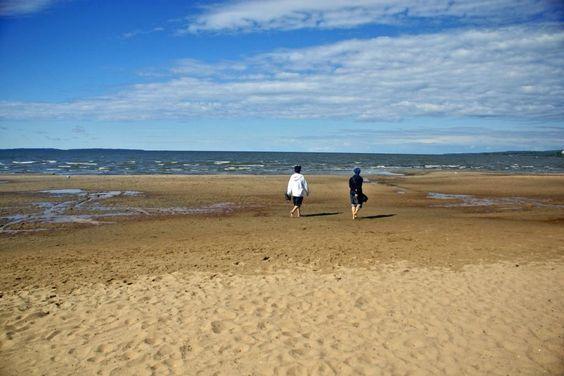 Friends walking the sandy beach of North Bay's Lake Nipissing (photo: Dave Melnychuk)
