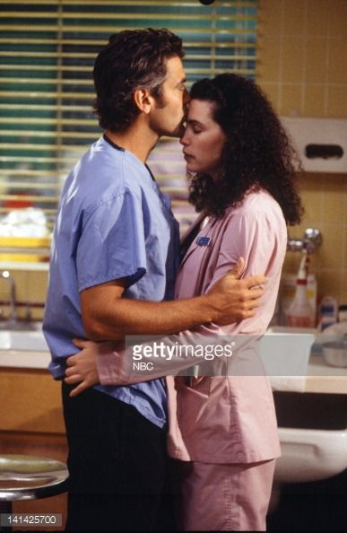 ER -- 'Of Past Regret and Future Fear' Episode 20 -- Air Date -- Pictured: George Clooney as Doctor Doug Ross, Julianna Margulies as Nurse Carol Hathaway -- Photo by: Paul Drinkwater/NBCU Photo Bank