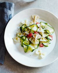 Marinated Zucchini with Bow Ties: Garden-fresh zucchini and tomatoes make a beautiful pasta, perfect for a warm summer night's dinner. It can be served hot or at room temperature, either for four as a main course or for eight as a side dish.