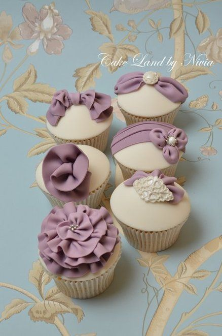 Purple and white cupcakes.Love this !