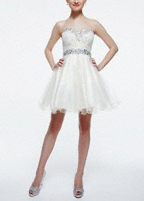 Super chic and ultra girlie, you will shine in this stunning tulle homecoming dress!  Strapless sweetheart bodice features heavily beaded neckline and waist.  Short tulle skirt adds drama and dimension.  Fully lined. Back zip. Imported polyester. Professional spot clean. Available in Plus sizes as Style 698741W.