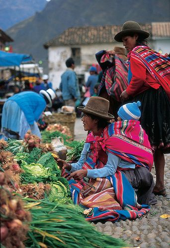 Pisac Market, Peru. Repinned by Elizabeth VanBuskirk. If those at the market have brought corn to trade or sell, you know they live in the lowlands, like the river valley near Pisac. One major purpose of Andean markets is for people who live at the high altitudes--eg 12,000 above sea level can come to market to trade their potatoes, which can be grown high up, for lower products like vegetables, fruit, corn.: