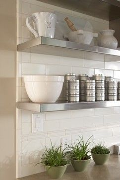 For where you need storage on the kitchen wall try open shelving over subway tile.