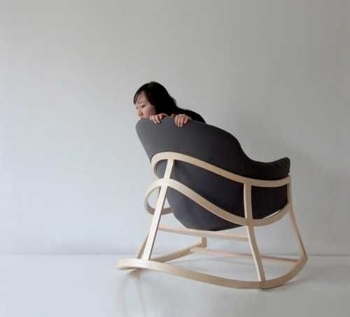 modern rocking chair with wooden frame and upholstered seat