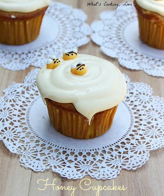 Honey Vanilla Cupcakes with Honey Buttercream Frosting.  These delicious and moist honey cupcakes are inspired by The Many Adventures of Winnie the Pooh.  #disneywinnie #cupcake #honey