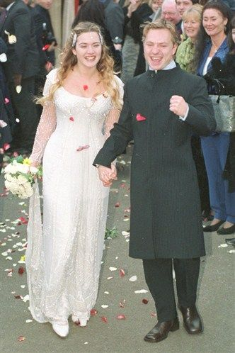 """Actress Kate Winslet looked gorgeous in her personally designed Alexander McQueen gown on her wedding to English director Jim Threapleton in 1998. They divorced in 2001.  She married Richard Branson's nephew """"Rocknroll"""" December 2012."""