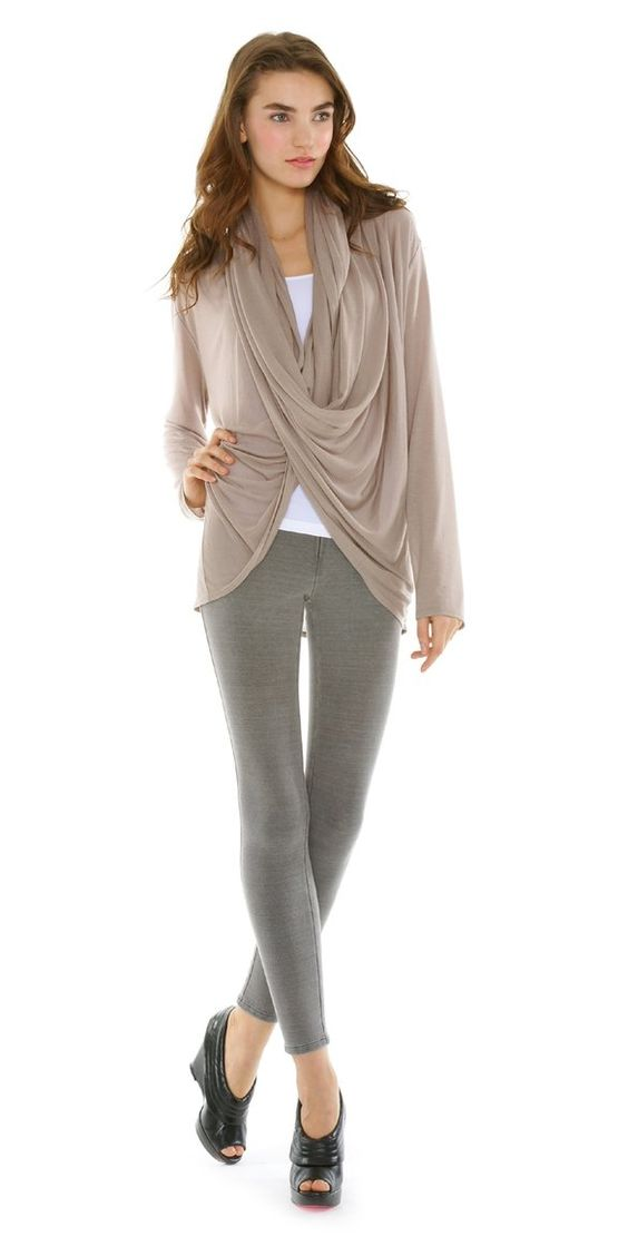 """Here's a deep v-neck cardigan sweater that """"wraps around"""" in a sexy but slouchy way. Ribbing draws in the eye to show off the curves of your waist, but stretches just in case! Below the ribbing, side vents allow the sweater to drape nicely around the hips, but still add warmth for chilly days. Perfect with leggings or a pencil skirt, this long sweater has a retro appeal.5/5(1)."""
