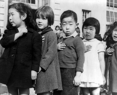 Dorothea Lange.    Japanese- American children, pledging allegiance to the American flag. Japanese Internment Camp.