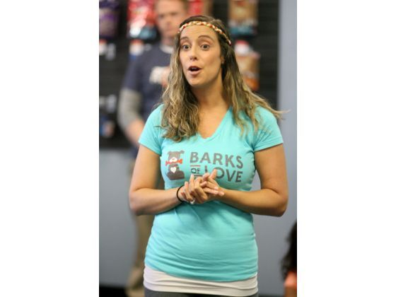 Ashley Cunningham, president and founder of Barks of Love animal rescue foundation speaks to Pup Scouts members and owners during a meeting ...