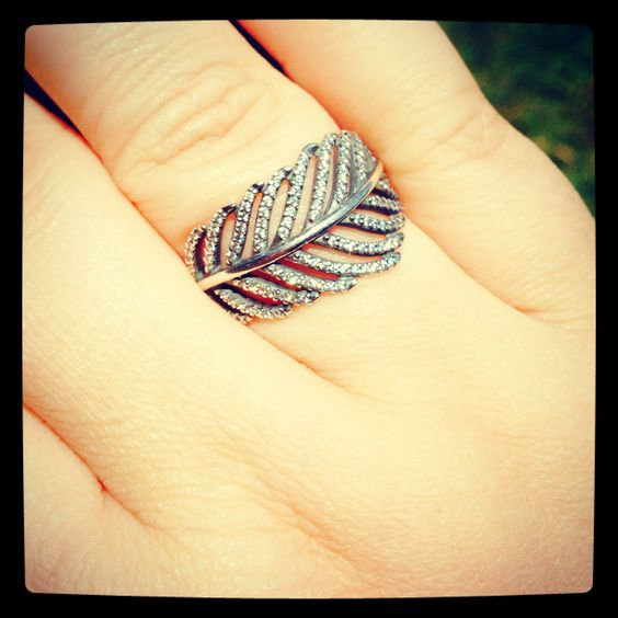 I want this pandora feather ring. Soooo pretty. Pandora, I take back all the mean comments I have made in the past.