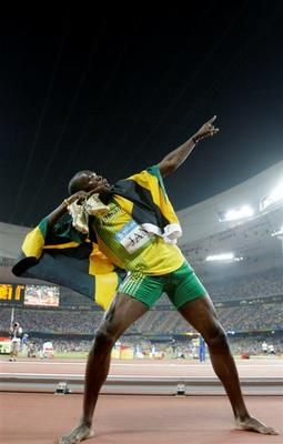 2008 Beijing Summer Olympics - Usain Bolt's legs put on just as much of a show at the 2008 Olympics as his ego. His salute after the 4x100-metre relay is the image of his career.
