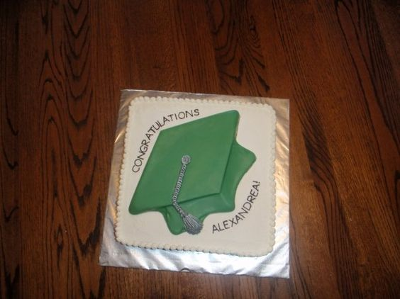 graduation cake with buttercream icing, green candy melts cap,