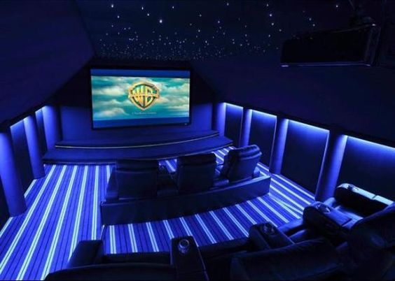 I would make one of my rooms the cinema room where I would have more than 100000 movies :) and I would do movie days and invite people.