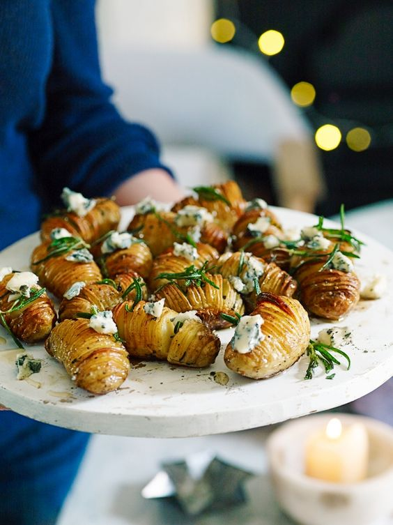 Guests won't be able to resist these bite-sized crispy potatoes, roasted with rosemary and honey and topped with crumbled gorgonzola