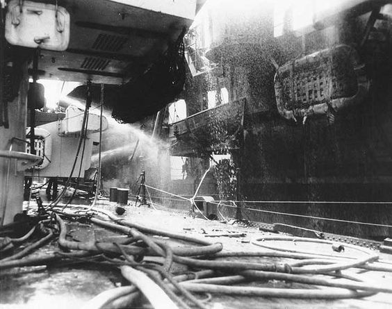 Battle of Leyte Gulf: light cruiser USS Birmingham assisted with firefighting on damaged light carrier USS Princeton, seen from foredeck, 24 Oct 1944