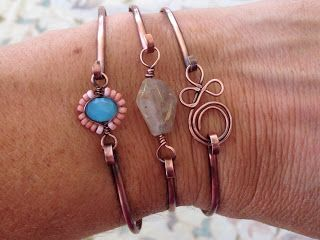 Lisa Yang's Jewelry Blog: Quick Copper Wire Focal Bead Bracelets  I'm thinking this would look good with leather, too.