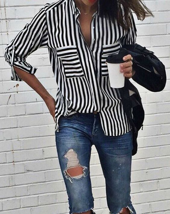 Shalice Noel rocks the vertical stripe trend in this statement shirt.   Brands not specified.