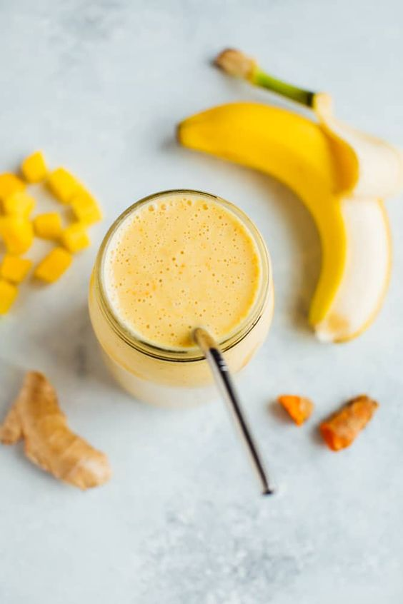 This golden milk smoothie with fresh turmeric, ginger and mango is the perfect way to refuel after a workout. It's got the protein and carbs your body needs along with anti-inflammation properties to help your body recover. #antiinflammatory #goldenmilk
