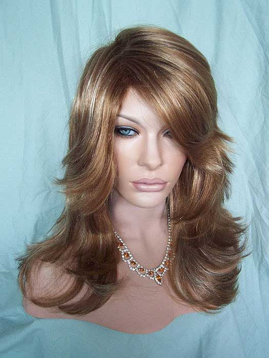 Tarah, one of our favorite wigs. Extra long bangs in highlighted Strawberry Blonde