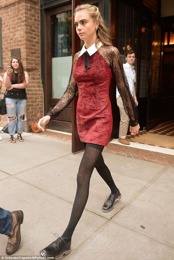 Ready for business: Cara Delevingne,23, looked glamorousas she embarked on promotion for...