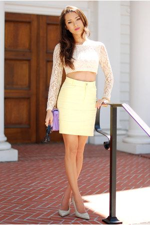 Love the hint of color given by the clutch and skirt.