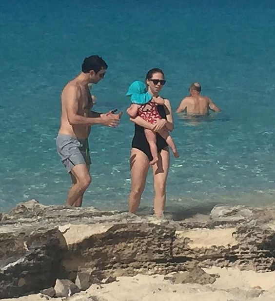Life's a beach: Chelsea Clinton, her husbandMarc Mezvinsky and their young daughter. Pregnant Chelsea Clinton takes a break from campaign trail for a stay at one of Turks and Caicos' priciest resorts where villas cost up to $34,000 a night