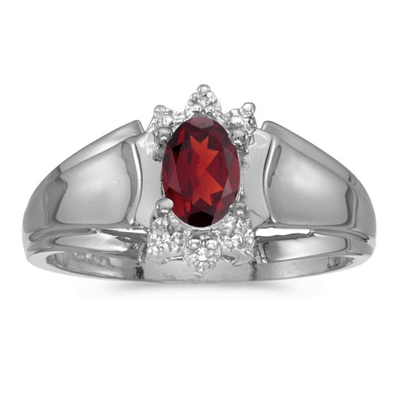 10k White Gold Oval Garnet And Diamond Ring (Size 6). Beautiful complimentary gift box included with this purchase. Setting made entirely with genuine solid 10 karat gold. Main stone size: 6x4 mm. All gemstones are genuine. 30 Day Satisfaction Guarantee.