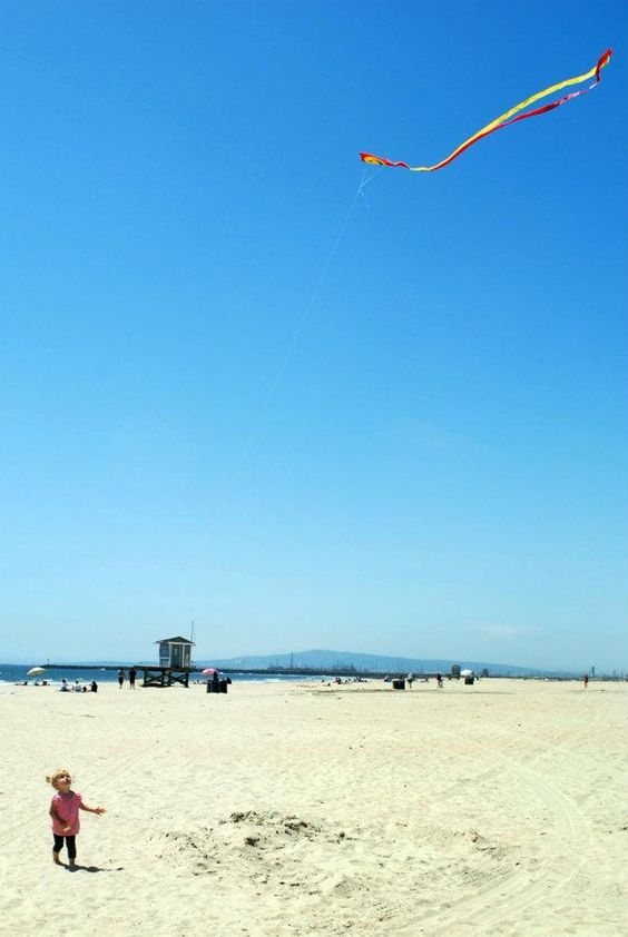 Seal Beach. Visit the kite shop on Main Street, and fly kites on the beach. (Water here is yucky) Kite shop link: http://www.upupandawaykites.com/