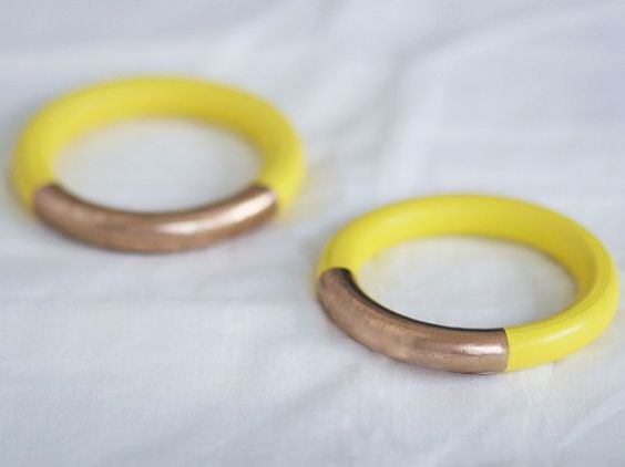 gold dip bangles.  bright colors+tape+gold spray paint= fun new accessory!