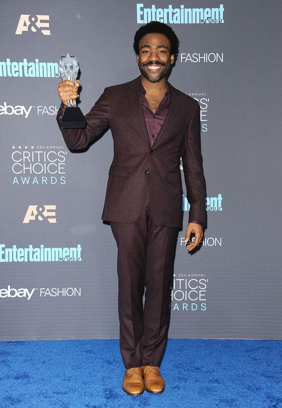 Donald Glover, Childish Gambino wearing Burberry tailoring to accept his award for Best Actor in a Comedy Series at the Critics Choice Awards