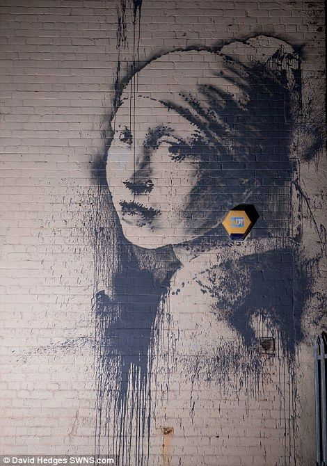 Banksy's version of Girl With A Pearl Earring appears on Bristol wall   Daily Mail Online