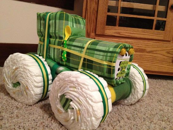 This is a diaper John Deere tractor I made for my husband's cousin's babyshower. It contains 100 size 1 diapers, a flannel receiving blanket(handmade 30x30), a fleece blanket(handmade 36x36), a dishwasher basket, and a spoon.