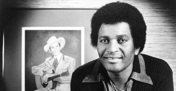 <3 Charley Pride <3 (with portrait of Hank Williams in background)