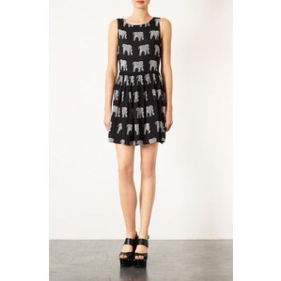Lovely NWT Topshop elephant dress Brand new with tag. Originally $72 make me offers.!!! Needs to go! Bundle and save on ship Topshop Dresses