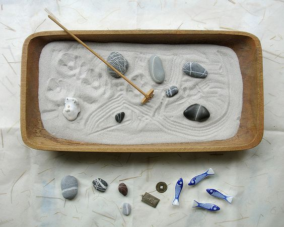 zen gardens ~ few can resist dragging the rake thru these (never outgrow a sandbox)! I've had them in the house for a few years.