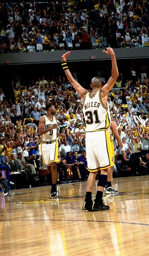 Reggie Miller #31 of the Indiana Pacers raises his arms against the Los Angeles Lakers during Game Three of the 2000 NBA Finals played June 11, 2000 at Conseco Fieldhouse in Indianapolis, Indiana.