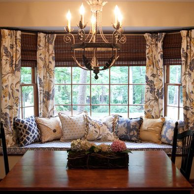 Window seat in dining room bay window love the draperies for Window seat dining